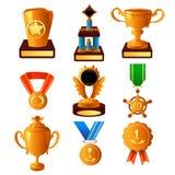 Gouden medaille en trofeepictogrammen Stock Foto