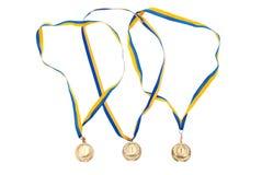 Gouden medailles die op wit worden geïsoleerde Royalty-vrije Stock Afbeeldingen
