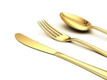 Gouden mes, vork, lepel Stock Foto