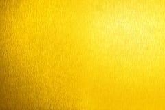 Gouden metaal glanzende lege oppervlakte, gele glanzende metaalachtergrond, gouden bladachtergrond dicht omhoog, decoratieve het  royalty-vrije stock foto
