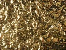 Gouden metaaltextuur - verfrommelde aluminiumfolie Stock Fotografie