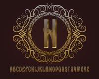 Gouden monogrammalplaatje in gevormd elliptisch kader met gestreept alfabet stock illustratie