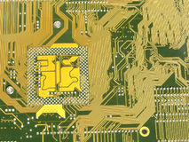 Gouden motherboard met kring royalty-vrije stock foto's