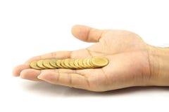 Gouden muntstuk directe lijn op hand Stock Afbeelding