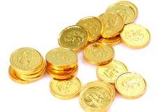 Gouden muntstukken stock afbeeldingen
