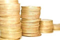 Gouden Muntstukken op witte achtergrond Macro Royalty-vrije Stock Afbeelding