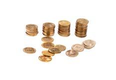 Gouden muntstukken in stapels Royalty-vrije Stock Afbeeldingen