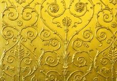 Gouden muur met ornament Stock Afbeelding