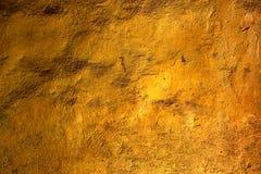 Gouden muurtextuur Stock Afbeeldingen