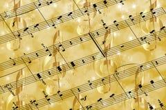 Gouden muziek en sterrenachtergrond stock fotografie