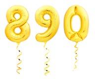 Gouden nummer 8, 9, 0 gemaakt van opblaasbare ballons met gouden die linten op wit worden geïsoleerd stock foto's