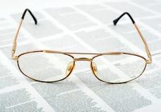 Gouden oogglazen Royalty-vrije Stock Afbeeldingen