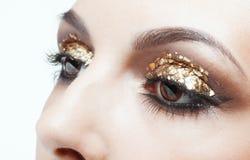 Gouden oogmake-up Stock Afbeeldingen