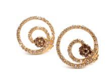 Gouden oorringen royalty-vrije stock afbeelding