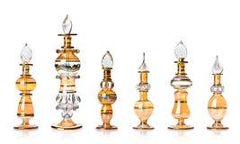 Gouden oosterse parfumflessen stock foto's