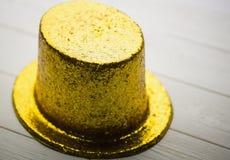 Gouden partijhoed Royalty-vrije Stock Afbeeldingen