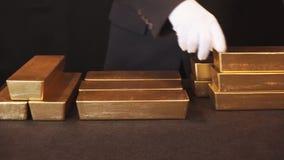 Gouden passement, goudstaven stock videobeelden