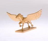 Gouden pegasus Stock Foto's