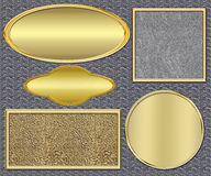 Gouden platen op een metaal Royalty-vrije Stock Afbeeldingen