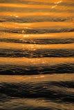 Gouden rimpelingen stock foto