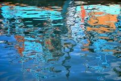 Gouden rimpelingen in water Stock Fotografie