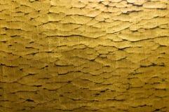 Gouden rimpelingsachtergrond Royalty-vrije Stock Foto's