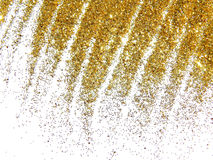 Gouden schitter fonkeling zoals een gouden regen op witte achtergrond Stock Foto