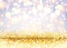 Gouden schitter op Glanzende achtergrond stock fotografie