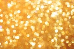 Gouden schitterende Kerstmislichten Vage abstracte achtergrond Royalty-vrije Stock Foto