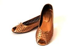 Gouden schoenen Stock Foto's