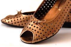 Gouden schoenen Stock Foto