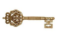 Gouden sleutel die op wit wordt geïsoleerdo Royalty-vrije Stock Foto