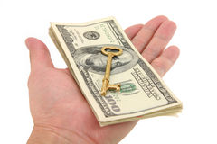 Gouden sleutel en dollars Stock Foto's
