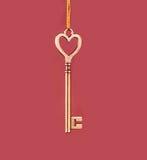 Gouden sleutel op een roze achtergrond Royalty-vrije Stock Afbeelding