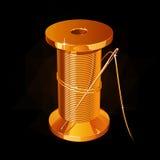 Gouden spoel van draad met een naald op een zwarte achtergrond Royalty-vrije Stock Foto's
