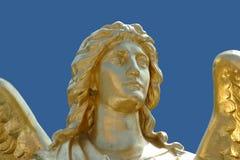 Gouden standbeeld van engel stock afbeeldingen