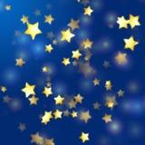 Gouden sterren in blauw Stock Foto's