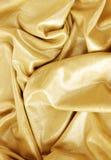 Gouden stoffentextuur Royalty-vrije Stock Fotografie