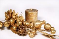 Gouden tak en kaars Stock Afbeelding