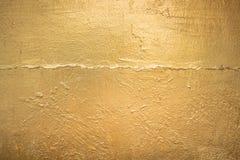 Gouden textuur als achtergrond Stock Afbeeldingen