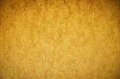 Gouden textuur als achtergrond Behang op de muur stock foto