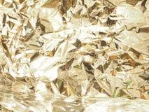 Gouden textuur met metaalglans gezichten stock foto