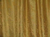 Gouden textuur van stof met de golven Stock Afbeeldingen