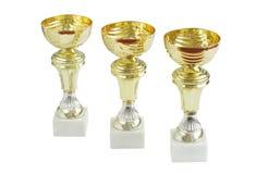 Gouden trofeeën die op wit worden geïsoleerdj royalty-vrije stock afbeelding