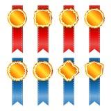 Gouden uitstekende kentekens met lint. Stock Fotografie