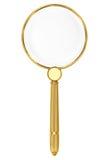 Gouden vergrootglas Stock Foto's