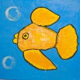 Gouden vissen op blauw Stock Foto