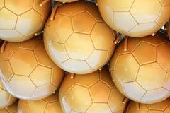 Gouden Voetbalballen Royalty-vrije Stock Afbeeldingen