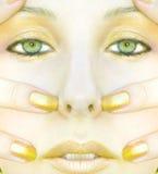 Gouden vrouwengezicht stock afbeelding