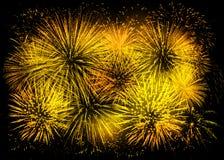 Gouden vuurwerkachtergrond stock afbeeldingen